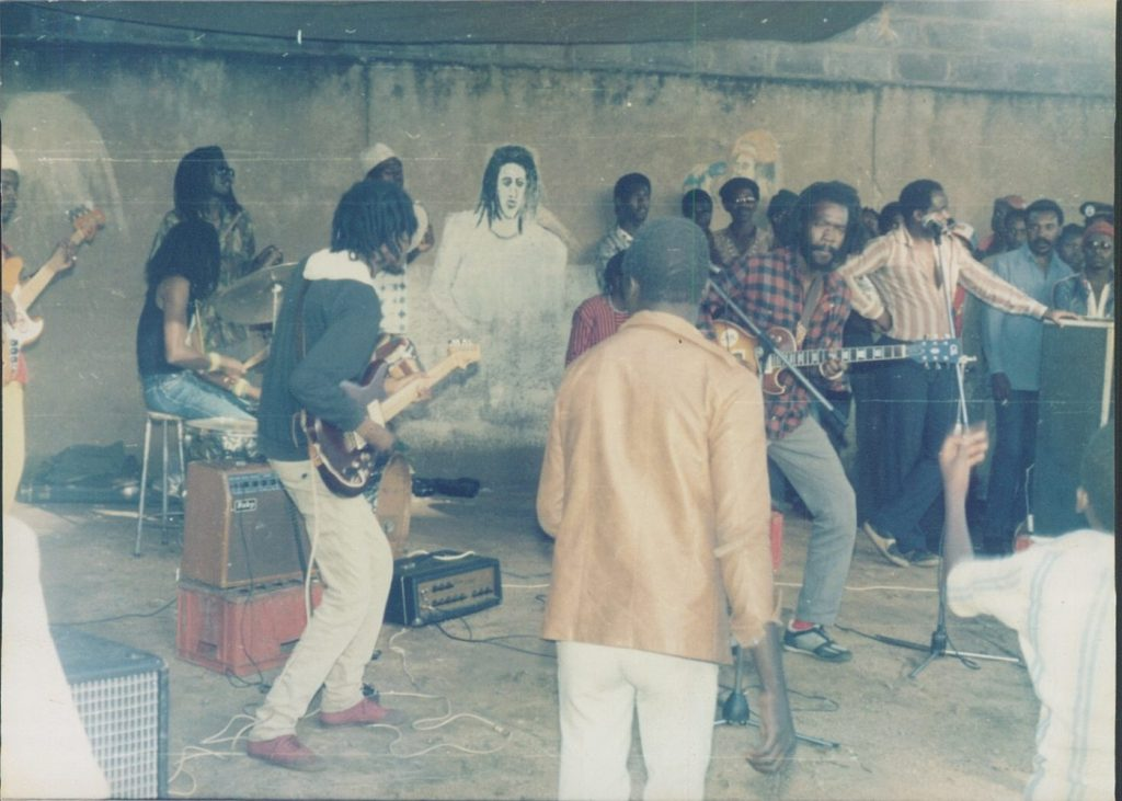 Rewind back to 1984 in Zambia. Shadrek Mutemwa on bass, Brian Chengala Shakarongo on drums, Spuki Mulemwa at the back playing cowbell, Zeko (Simwinji) on rhythm guitar, Sikota in red at the back, yours truly on guitar and vocal, Jimmy Mvula and Marc Boti on the right at Star Market in Lusaka